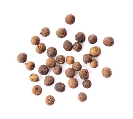 Allspice berries (also called Jamaican pepper or newspice) over white background. top view