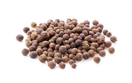 Allspice berries (also called Jamaican pepper or newspice) over white background. Stock Photo