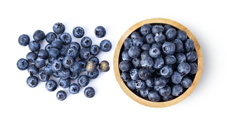 Blueberries in wood bowl  isolated on white background. top view