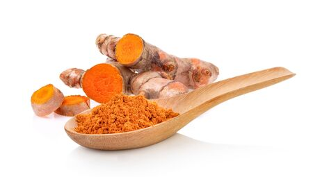 Turmeric powder in wood spoon isolated on white background. full depth of field