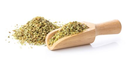 Pile of dried oregano leaves in wood scoop isolated on white background full depth of field Reklamní fotografie
