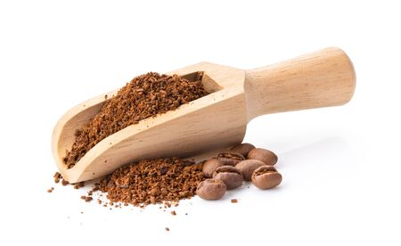 coffee powder in wood scoop isolated on white background