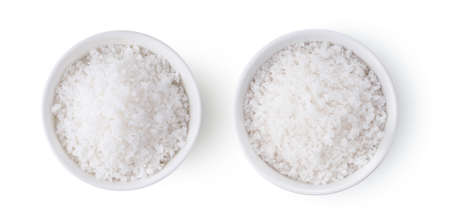 salt in white bowl isolated on white background top view