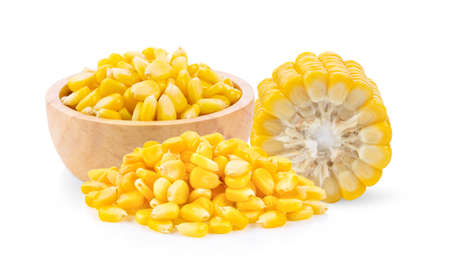 Corn seeds in wood bowl isolated on the white background