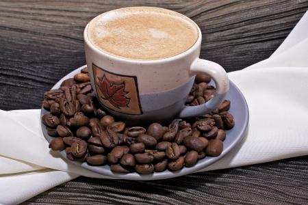 šálek kávy s pěnou na pozadí tkáně Reklamní fotografie - 14409782