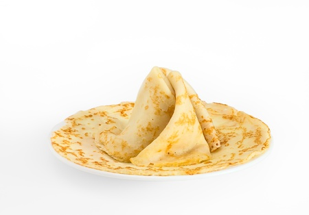 Fried pancakes decorated as a pyramid on a white background photo