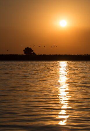 volga river: Autumn red sunset in the delta of the Volga River