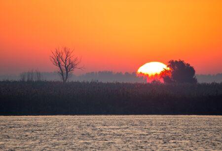 volga river: Bright sunrise over the delta of the Volga River