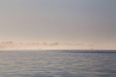 the volga river: Foggy coast of the delta of the Volga River Stock Photo