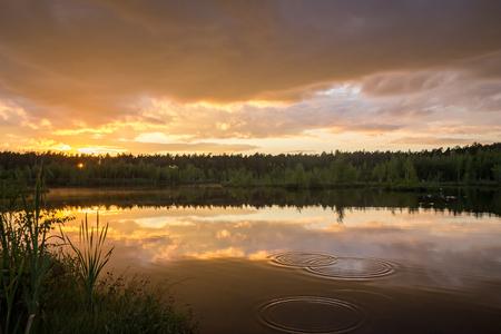 Summer sunset over the lake Фото со стока - 89971766
