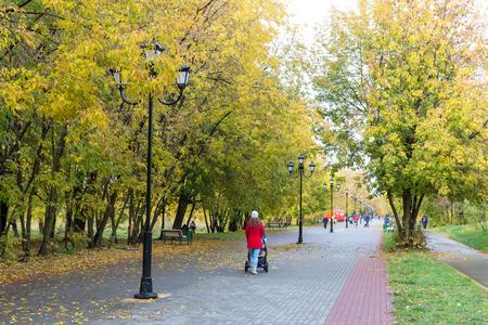 Balashikha, Russia - October 12 2017: People walk around the autumn city alley