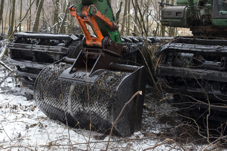 Balashikha, Moscow region, Russia - December 05, 2017: A floating excavator cleans the bottom of the Pekhorka River from mud and banks from the thickets Редакционное