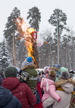 Balashikha, Moscow area. Russia - December 18, 2018: Farewell to Shrovetide and burning of an effigy on the square at the city park