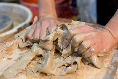 Hands close up to sculpture products from clay