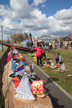 Kholuy, Ivanovo Region, Russia - April 28, 2018: Revival of the old tradition, the artistic painting of boats and their descent into the water during the spring flood of the Teza River Редакционное