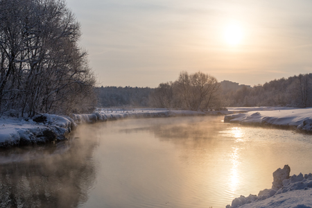 The Pekhorka River frosty winter in the morning in beams not of a bright sun