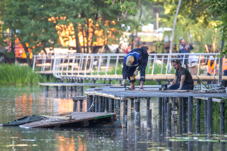 Balashikha, Moscow area, Russia - June 16, 2018: Construction of the embankment of a zone on the river bank of Pekhork in the territory of the city park