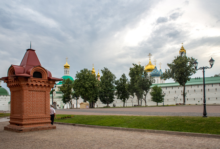 Sergiyev Posad, Moscow area, Russia - June 24, 2018: People walk across the Trinity-Sergius Lavra territory in the warm summer evening