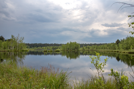 Summer landscape on Lake Yushino with rain clouds