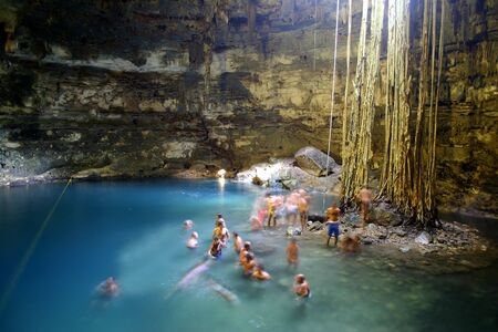 People bathing in limestone cave lake in Yucatan, Mexico