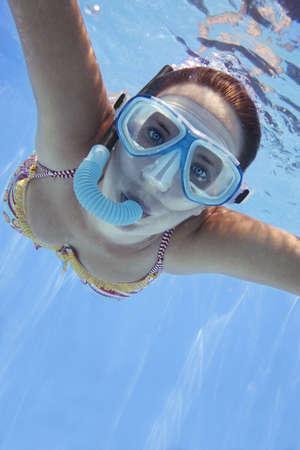 Girl in bikini swimming underwater in blue pool Stock Photo - 1298033