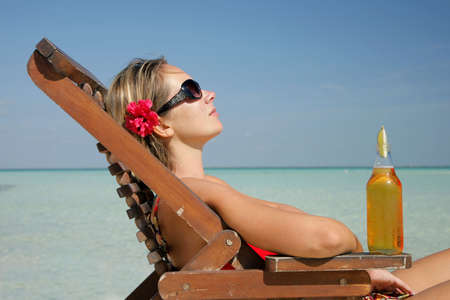 Woman in deckchair with beer Stock Photo - 2954027