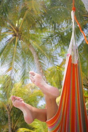 Woman in a hammock on a tropical beach