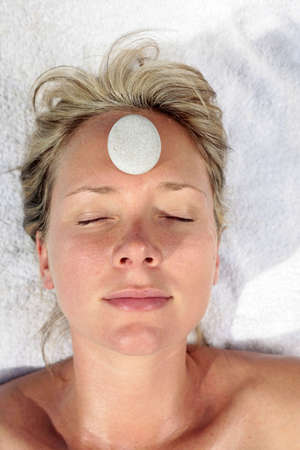 Woman at a spa with white stone on her forehead Stock Photo - 5052630