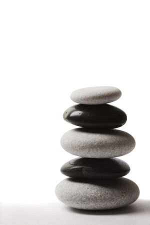 Stone stack made up of alternate black and white pebbles