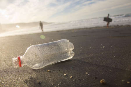 plastic pollution: A plastic bottl washed up on the beach