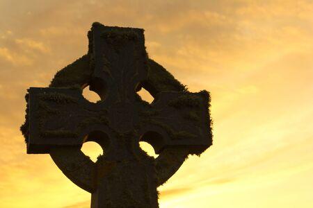 Celtic cross on sunset