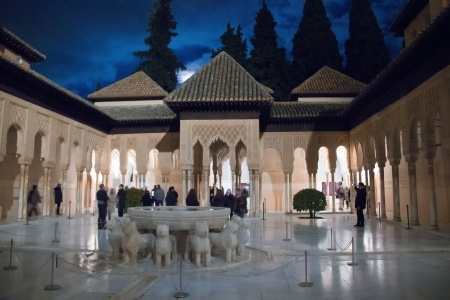 The Court of the Lions is the main court of the Nasrid dynasty Palace of the Lions, in the heart of the Alhambra, the Moorish citadel formed by a complex of palaces, gardens and forts in Granada, Spain