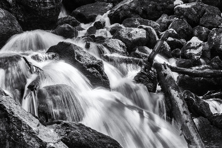 rushing water: Rushing water at The Eyes of the Devil or Eyes of Jupiter waterfall moving through rocks in Spain during the summer