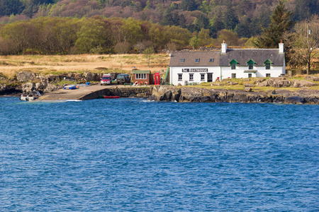 mull: Little boathouse restaurant near edge of water on the west coast of Mull at the island of Ulva