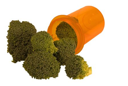 Broccoli pouring from a pill bottle Imagens