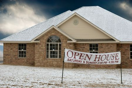 Newly constructed house for sale.Light snow on roof and ground