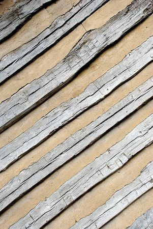 Background of diagonal boards in tan colored cement Imagens