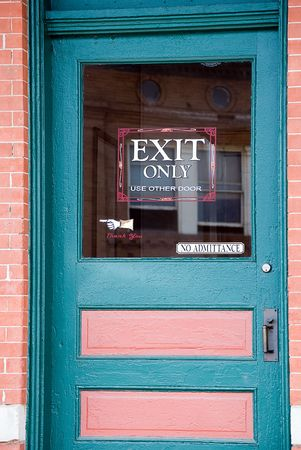 Blue and pink door with exit only sign