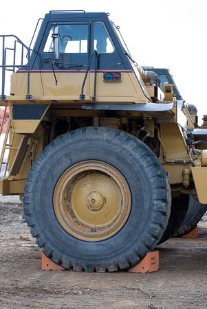 Cab and large front tire of huge dump truck