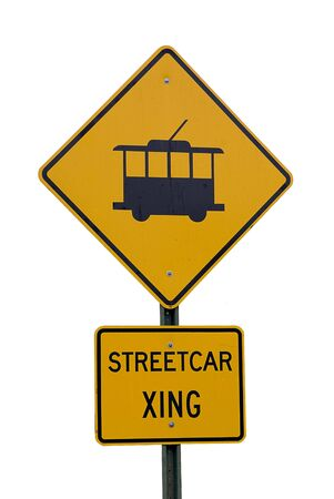 Yellow warning sign for streetcar crossing