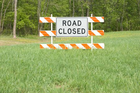 Road closed sign in middle of field