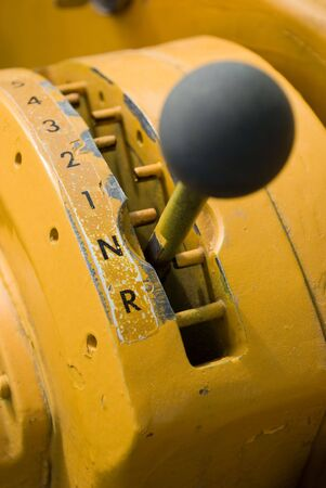 Close up of gear shifter used on earth mover
