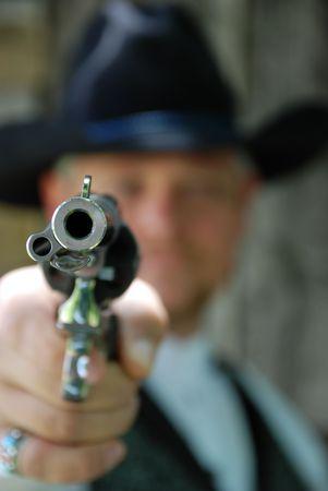 bounty: Man aiming pistol Stock Photo