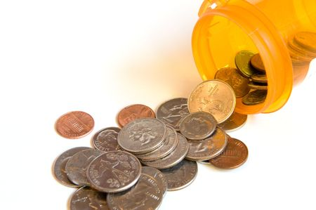 Coins pouring from a pill bottle