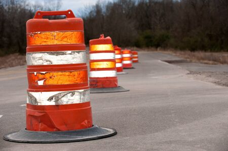 Row of Large Traffic cones on old road Stock Photo
