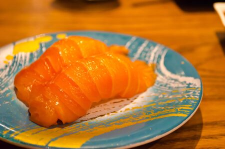 Two Salmon sushi on a plate. Stock Photo - 16167366