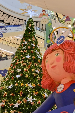 huge christmas tree: BANGKOK - 25 NOV 2012 - A huge Christmas tree and angel dolls decoration in the main hall of Central World building. Editorial