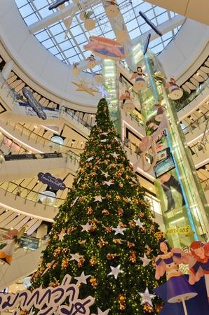 huge christmas tree: BANGKOK - 25 NOV 2012 - A huge Christmas tree decoration in the main hall of Central World building.