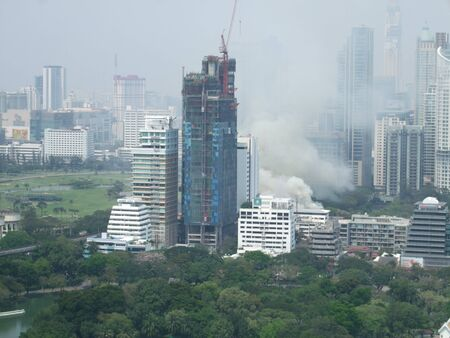 BANGKOK - 20 FEB 2013 - A smoke cover an old building of AUA during a fire, on Ratchadamri Road, February 20, 2013.