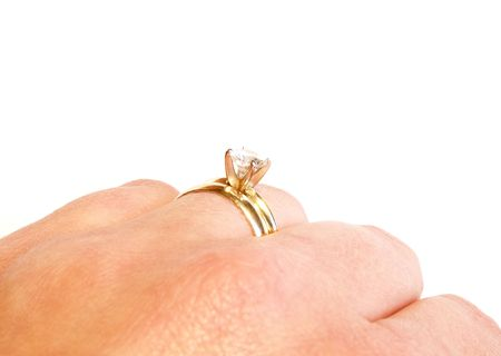 womans hand with wedding band and diamond engagement ring